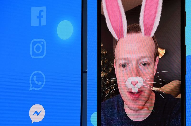 Facebook CEO Mark Zuckerberg is seen with digital bunny ears on-screen during the annual F8 summit at the San Jose McEnery Convention Center in San Jose, California on May 01, 2018. Facebook chief Mark Zuckerberg announced the world's largest social network will soon include a new dating feature -- while vowing to make privacy protection its top priority in the wake of the Cambridge Analytica scandal. / AFP PHOTO / JOSH EDELSON