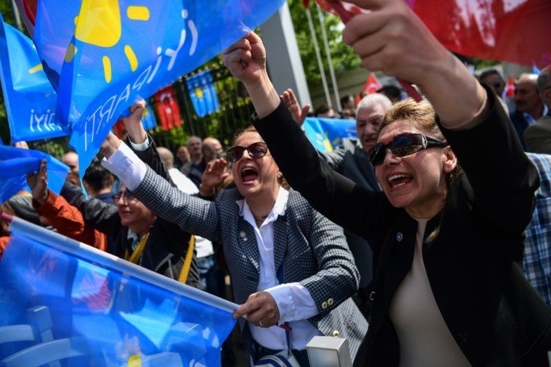 Supporters of Turkey's Iyi (Good) opposition party wave party flags as they came outside the Supreme Election Board (YSK) uskudar's headquarter on May 4, 2018 in Istanbul where party leader Meral Aksener camee to start her camepain and gather signatures ahead of the presidential polls in June 24. / AFP PHOTO / OZAN KOSE