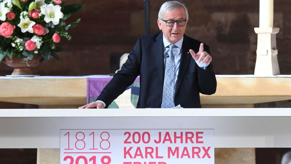 European Commission President Jean-Claude Juncker speaks on May 4, 2018 at the Basilica of Constantine in Trier, southwestern Germany, the birthplace of Karl Marx, during a ceremony ahead of the opening of major exhibitions on the revolutionary thinker.On May 5, 2018, is the 200th anniversary of Marx's birth. / AFP PHOTO / Patrik STOLLARZ