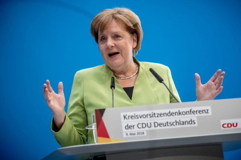 "German Chancellor Angela Merkel gives a speech during a meeting with regional leaders of her conservative Christian Democratic Union (CDU) party in Berlin on May 9, 2018. Germany, France and Britain will ""do everything"" to ensure that Iran remains in the landmark 2015 nuclear deal, Chancellor Angela Merkel vowed during the meeting, a day after the US pulled out of the accord. ""We will remain committed to this agreement and will do everything to ensure that Iran complies with the deal,"" Merkel said, adding that Berlin had made the decision jointly with Paris and London.  / AFP PHOTO / dpa / Michael Kappeler / Germany OUT"