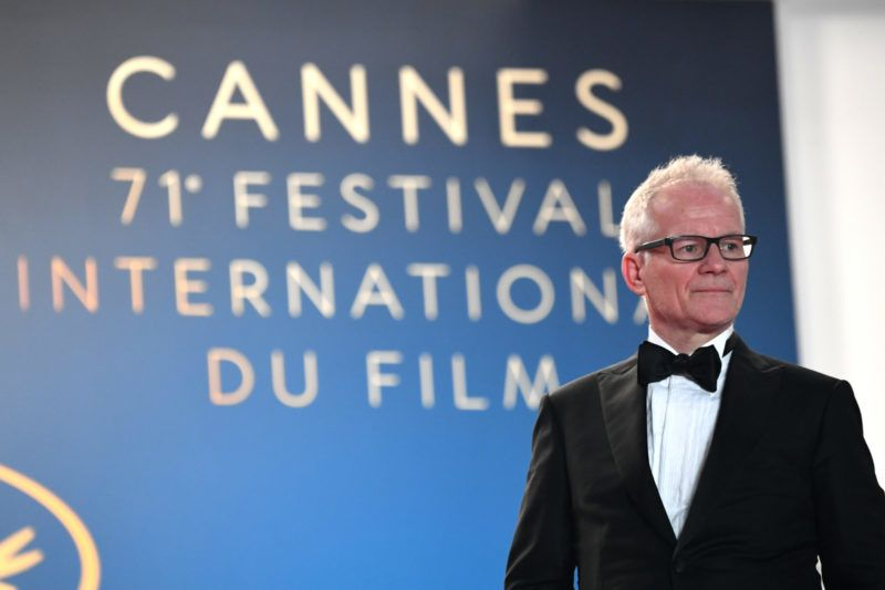 "The General Delegate of the Cannes Film Festival Thierry Fremaux looks at guests arriving on May 16, 2018 for the screening of the film ""Dogman"" at the 71st edition of the Cannes Film Festival in Cannes, southern France.  / AFP PHOTO / LOIC VENANCE"