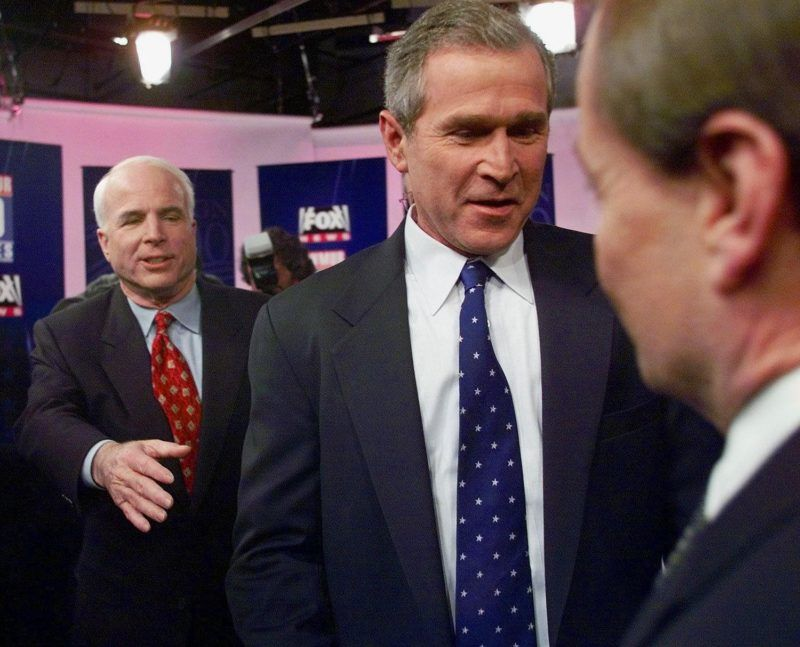 Republican presidential hopefuls (L-R) Sen. John McCain, Texas Gov. George W. Bush and  Gary Bauer leave after a debate forum at a local television station in Manchester, New Hampshire 02 December, 1999.     (ELECTRONIC IMAGE)  POOL/AFP PHOTO ELISE AMENDOLA  / AFP PHOTO / AP POOL / ELISE AMENDOLA