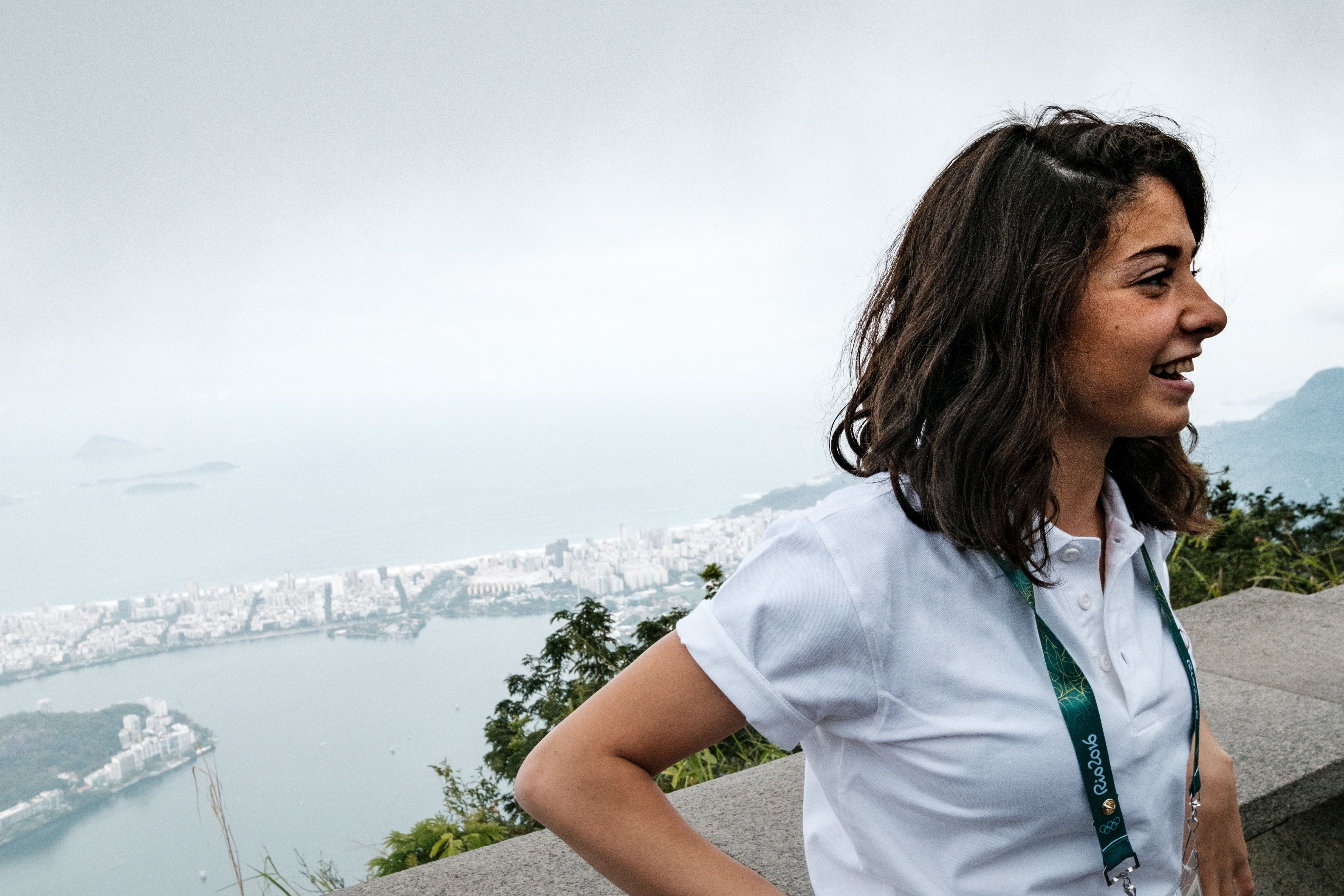Syria's swimmer Yusra Mardini based in Germany for the Refugee Olympic Team (ROT) visits the statue of Christ the Redeemer, ahead of Rio 2016 Olympic games in Rio de Janeiro, Brazil, on July 30, 2016. The International Olympic Committee (IOC) selects 10 refugee athletes to set a refugee's team for the first time, to bring about hope to people displaced by conflicts or war in the world. / AFP PHOTO / YASUYOSHI CHIBA