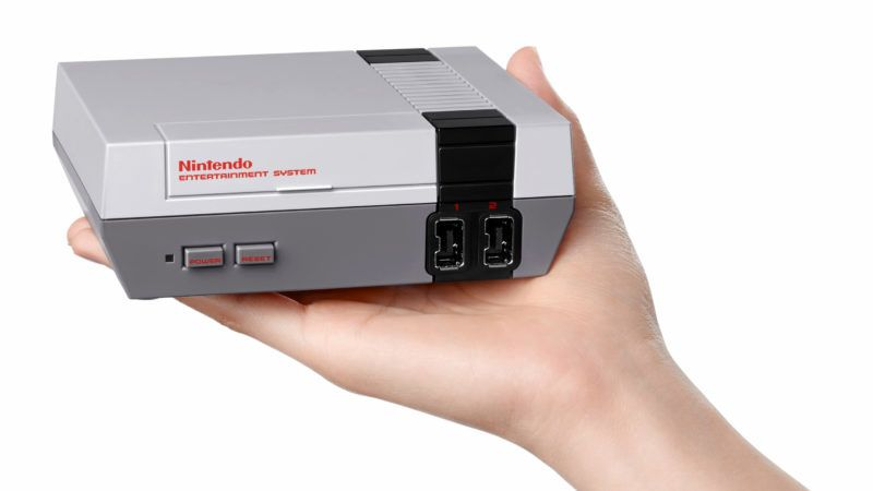 """This undated picture released by Nintendo on November 10, 2016 shows the North American version of the eighties era games console, """"Nintendo Entertainment System: NES Classic Edition"""".  Nintendo on November 10 launched a palm-sized version of its eighties era games console, setting up an old versus new showdown with rival Sony as it released a new PlayStation 4. / AFP PHOTO / Nintendo / STR / RESTRICTED TO EDITORIAL USE - MANDATORY CREDIT """"AFP PHOTO / (c)2016 Nintendo"""" - NO MARKETING - NO ADVERTISING CAMPAIGNS - DISTRIBUTED AS A SERVICE TO CLIENTS"""