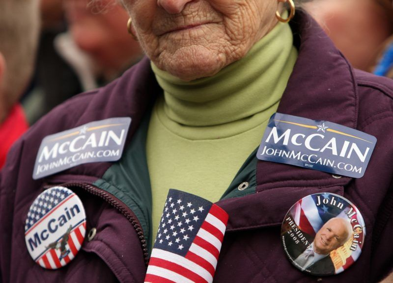 An elderly supporter of US Republican presidential hopeful John McCain displays her voting choice at a rally in front of the State House in Concord 07 January 2008. McCain is on the campaign trail to try to win New Hampshire's primary election 08 January.           AFP PHOTO/Emmanuel DUNAND / AFP PHOTO / EMMANUEL DUNAND
