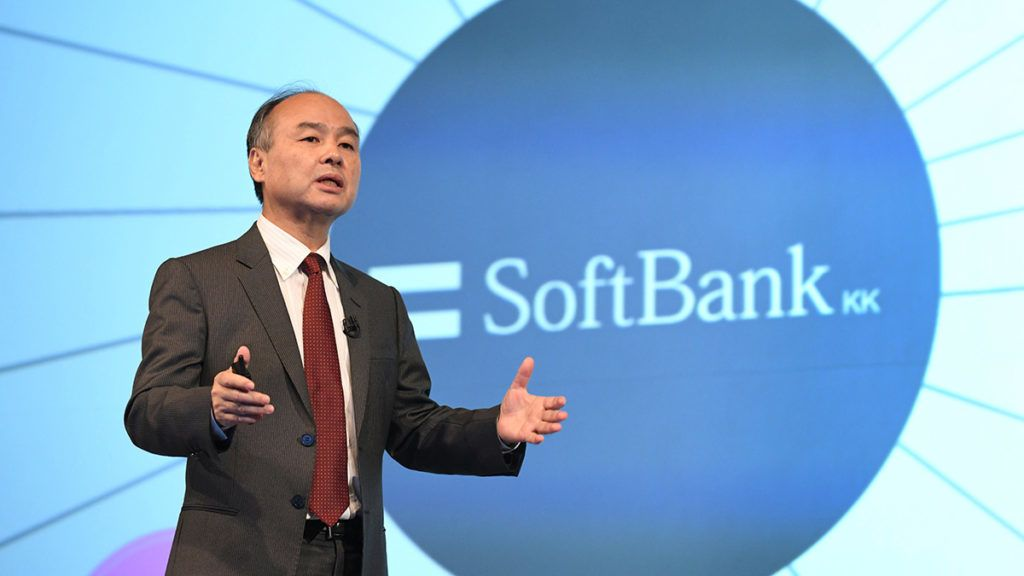 SoftBank Group Corp Chairman and CEO Masayoshi Son gestures as he delivers a speech during a press briefing to announce the company's financial results in Tokyo on February 7, 2018.Japanese telecoms giant SoftBank on February 7 said it had begun preparing to list its mobile unit in a move reports said could raise up to $18 billion, making it one of the country's biggest ever initial public offerings. / AFP PHOTO / Kazuhiro NOGI