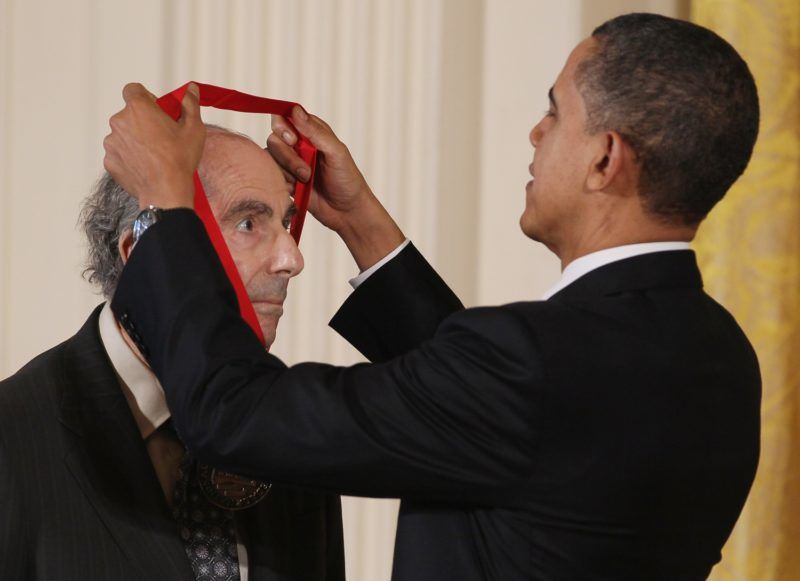 """FILE - MAY 22: Pulitzer Prize-winning novelist Philip Roth has died at 85. His novel """"American Pastoral"""" won the Pulitzer Prize for Fiction in 1998. WASHINGTON, DC - MARCH 02: U.S. President Barack Obama presents the 2010 National Humanities Medal to novelist Philip Roth during a ceremony in the East Room of the White House, on March 2, 2011 in Washington, DC. President Obama presented the 2010 National Medal of Arts and National Humanities Medal to 20 honorees   Mark Wilson/Getty Images/AFP"""
