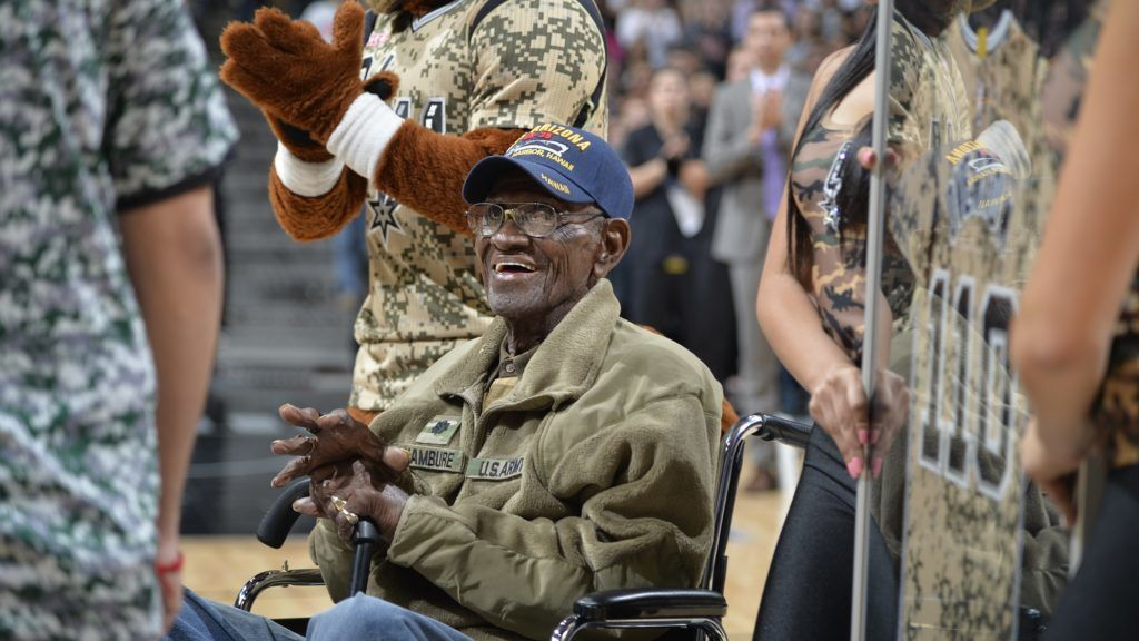 SAN ANTONIO, TX - MARCH 23: The San Antonio Spurs honor Richard Overton, the oldest living U.S. veteran at Military Appreciation Night during the game between the San Antonio Spurs and Memphis Grizzlies on March 23, 2017 at the AT&T Center in San Antonio, Texas. NOTE TO USER: User expressly acknowledges and agrees that, by downloading and or using this photograph, user is consenting to the terms and conditions of the Getty Images License Agreement. Mandatory Copyright Notice: Copyright 2017 NBAE   Mark Sobhani/NBAE via Getty Images/AFP