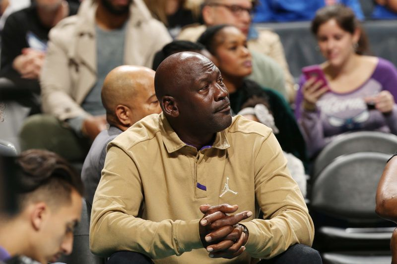 CHARLOTTE, NC - JANUARY 12: Michael Jordan attends the game between the Utah Jazz and the Charlotte Hornets on January 12, 2018 at Spectrum Center in Charlotte, North Carolina. NOTE TO USER: User expressly acknowledges and agrees that, by downloading and or using this photograph, User is consenting to the terms and conditions of the Getty Images License Agreement. Mandatory Copyright Notice: Copyright 2018 NBAE   Kent Smith/NBAE via Getty Images/AFP
