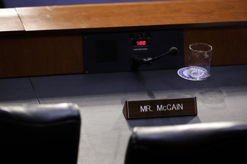 WASHINGTON, DC - MARCH 21: Arizona Republican Sen. John McCain's wooden nameplate sits on the dais during a Senate Intelligence Committee in the Hart Senate Office Building on Capitol Hill March 21, 2018 in Washington, DC. Homeland Security Secretary Kirstjen Nielsen and former Secretary of Homeland Security Jeh Johnson faced questions from committee members about election security.   Chip Somodevilla/Getty Images/AFP