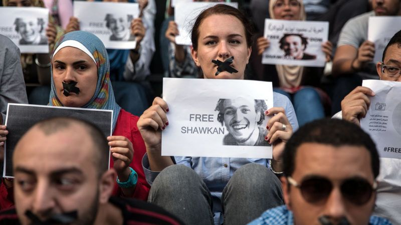 CAIRO, EGYPT - JULY 12:  A group of people gather at Adeviyye Rabiatul square to demonstrate, demanding the release of photojournalist Mahmoud Abou Zeid proffessionally known Shawkan, who was beaten and arrested by police during the Rabaa protests, in Cairo, Egypt, July 12, 2014. (Ahmed Ismail - Anadolu Agency)