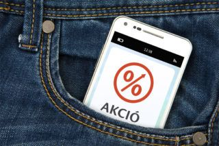 32272520 - mobile phone with discount coupon in jeans pocket