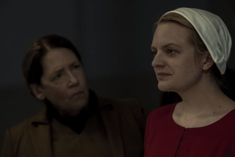 """THE HANDMAID'S TALE -- """"June"""" -- Episode 201 -- Offred reckons with the consequences of a dangerous decision while haunted by memories from her past and the violent beginnings of Gilead. Aunt Lydia (Ann Dowd) and Offred (Elisabeth Moss), shown. (Photo by:George Kraychyk/Hulu)"""