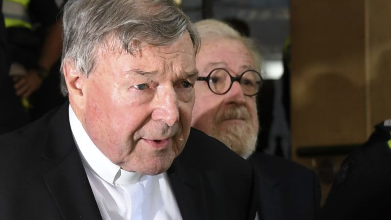Vatican finance chief Cardinal George Pell leaves after making an appearance in court in Melbourne on May 1, 2018. Pell pleaded not guilty on May 1 after being ordered to stand trial on multiple historical sexual offence charges in Australia. / AFP PHOTO / WILLIAM WEST