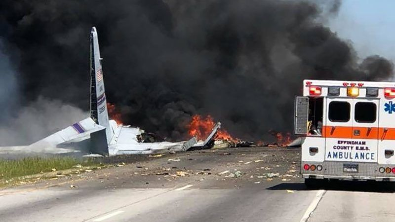 """This handout photo obtained May 2, 2018 courtesy of the Savannah International Association Fire Fighters(IAFF Local 574)shows a US military C130 engulfed in flames and smoke down at 21 and Gulfstream Road, in Savannah, Georgia. A military cargo plane with five people aboard crashed in the southern US state of Georgia on Wednesday, according to officials.  The emergency management agency for Chatham County, which comprises the city of Savannah, tweeted that a plane had crashed at a highway intersection. Georgia National Guard spokeswoman Desiree Bamba told AFP the aircraft was a C-130 carrying five people. It belonged to the Puerto Rico National Guard, and the condition of the occupants was not immediately known, she said.   / AFP PHOTO / IAFF574 Savannah / Handout / RESTRICTED TO EDITORIAL USE - MANDATORY CREDIT """"AFP PHOTO / IAFF574 SAVANNAH/HANDOUT"""" - NO MARKETING NO ADVERTISING CAMPAIGNS - DISTRIBUTED AS A SERVICE TO CLIENTS"""
