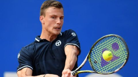 Hungary's Marton Fucsovics returns the ball to Germany's Maximilian Marterer during their quarter final match at the ATP tennis BMW Open in Munich, southern Germany, on May 4, 2018.  / AFP PHOTO / Christof STACHE