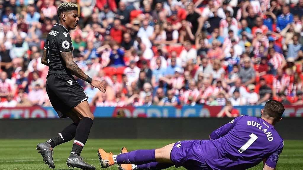 Crystal Palace's Dutch defender Patrick van Aanholt (L) watches the ball into the net after scoring his team's second goal past Stoke City's English goalkeeper Jack Butland during the English Premier League football match between Stoke City and Crystal Palace at the Bet365 Stadium in Stoke-on-Trent, central England on May 5, 2018. / AFP PHOTO / Oli SCARFF / RESTRICTED TO EDITORIAL USE. No use with unauthorized audio, video, data, fixture lists, club/league logos or 'live' services. Online in-match use limited to 75 images, no video emulation. No use in betting, games or single club/league/player publications.  /