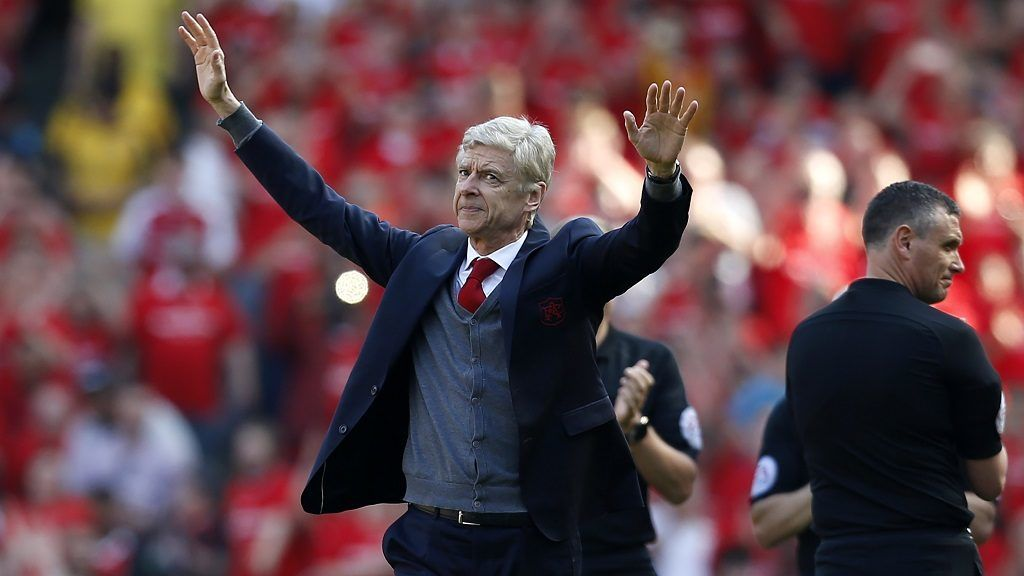 Arsenal's French manager Arsene Wenger salutes the crowd as he arrives for the English Premier League football match between Arsenal and Burnley at the Emirates Stadium in London on May 6, 2018.  Arsene Wenger bids farewell to a stadium he helped to build in more ways than one when he leads Arsenal at the Emirates for the final time at home to Burnley on Sunday. Wenger's final season after 22 years in charge is destined to end in disappointment after Thursday's Europa League semi-final exit.  / AFP PHOTO / IKIMAGES / Ian KINGTON / RESTRICTED TO EDITORIAL USE. No use with unauthorized audio, video, data, fixture lists, club/league logos or 'live' services. Online in-match use limited to 45 images, no video emulation. No use in betting, games or single club/league/player publications.  /