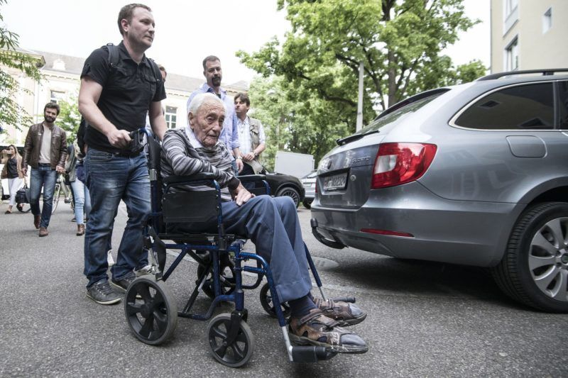 Australian scientist David Goodall arrives in a wheelchair to hold a press conference on May 9 2018, on the eve of his assisted suicide in Basel. 104-year-old Australian scientist David Goodall, resentful that he was forced overseas to die, is set to address the media in Switzerland on May 9, 2018, a day before he is due to end his life. He does not have a terminal illness but says his quality of life has deteriorated and that he wants to die. He was barred from seeking help to end his life in Australia, so he was forced to travel to Switzerland. / AFP PHOTO / SEBASTIEN BOZON