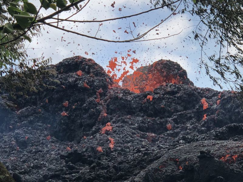 Lava erups from a newly formed fissure in Kapoko on Big Island in Hawaii, May 12, 2018.   A Hawaii volcano that has been oozing lava and burping steam for days may be gearing up for a huge eruption, scientists have warned, prompting the closure of Volcanoes National Park on May 11, 2018. It is the newest threat from the Kilauea volcano, which began erupting last Thursday, May 3, 2018, on the US state's Big Island, the National Park Service said.  / AFP PHOTO / Gianrigo MARLETTA