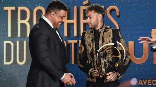 Paris Saint-Germain's Brazilian forward Neymar (R) receives the Best Ligue 1 Player award from former Brazilian international player Ronaldo during a TV show on May 13, 2018 in Paris, as part of the 27th edition of the UNFP (French National Professional Football players Union) trophy ceremony. / AFP PHOTO / FRANCK FIFE