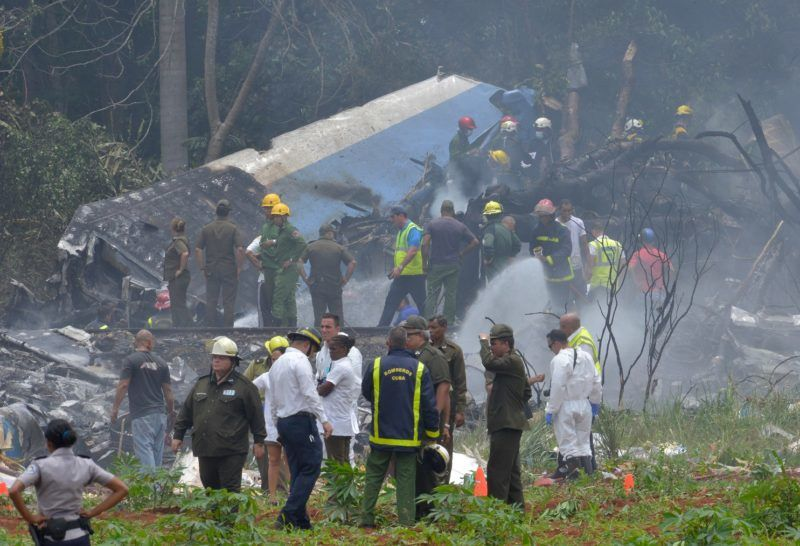 "Picture taken at the scene of the accident after a Cubana de Aviacion aircraft crashed after taking off from Havana's Jose Marti airport on May 18, 2018. A Cuban state airways passenger plane with 104 passengers on board crashed on shortly after taking off from Havana's airport, state media reported. The Boeing 737 operated by Cubana de Aviacion crashed ""near the international airport,"" state agency Prensa Latina reported. Airport sources said the jetliner was heading from the capital to the eastern city of Holguin.  / AFP PHOTO / Adalberto ROQUE"