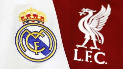 Picture shows detail of jerseys badges of Real Madrid CF and Liverpool FC football teams in Madrid on May 21, 2018.  Real Madrid CF and Liverpool FC football teams will play the UEFA Champions League final match in Kiev on May 26, 2018. / AFP PHOTO / Benjamin CREMEL