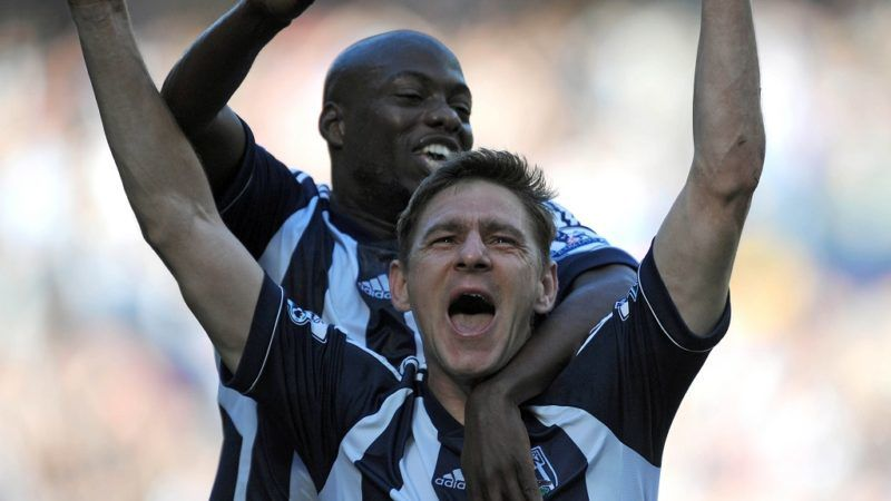"""West Bromwich Albion's Hungarian striker Zoltan Gera (R) celebrates scoring their second goal with Congolese midfielder Youssouf Mulumbu (L) during the English Premier League football match between West Bromwich Albion and Queens Park Rangers at The Hawthorns in West Bromwich, West Midlands, England on October 6, 2012. AFP PHOTO/OLLY GREENWOOD  RESTRICTED TO EDITORIAL USE. No use with unauthorized audio, video, data, fixture lists, club/league logos or """"live"""" services. Online in-match use limited to 45 images, no video emulation. No use in betting, games or single club/league/player publications. / AFP PHOTO / OLLY GREENWOOD"""