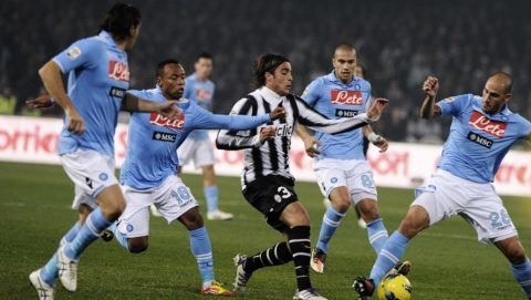 Juventus' Alessandro Matri (C)  is tackled by SSC Napoli's  (L-R) Salvatore Aronica, Camilo Zuniga, Gokan Inler and Paolo Cannavaro during their Serie A football match SSC Napoli vs Juventus at San Paolo Stadium in Naples on November 29, 2011. AFP PHOTO / ROBERTO SALOMONE / AFP PHOTO / ROBERTO SALOMONE