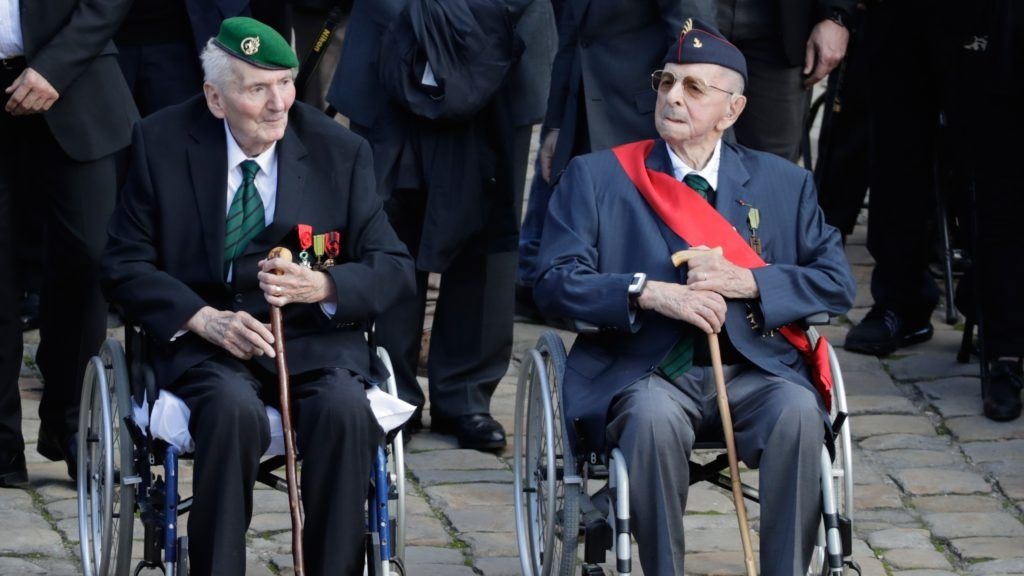 Hubert Germain (L) and Yves De Daruvar, both WWII veterans and 'Companions of the Liberation', attend a ceremony in tribute to late French WWII colonel Fred Moore at the Hotel des Invalides in Paris on September 22, 2017.  Moore, a 'Companion of the Liberation', passed away in Paris the age of 97 on September 16, 2017.  / AFP PHOTO / Thomas Samson