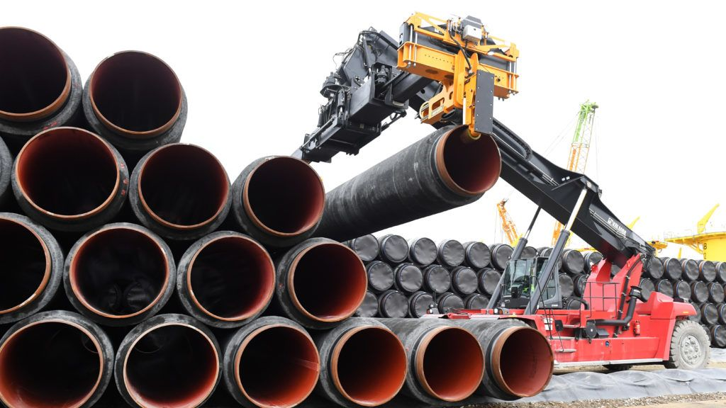 Pipes for the Baltic Sea pipeline being transported for loading onto a ship in the premises of the harbour in Mukran, Germany, 03 November 2017. About 54,000 steel pipes are being stored in Mukran on the island of Rugen, about one quarter of the pipes needed for the two pipeline stretches. Of these pipes about 6000 have already been encased with cement, of whcih about 3600 have already been brought to their final destination in Karlshamn, Sweden. Photo: Stefan Sauer/dpa