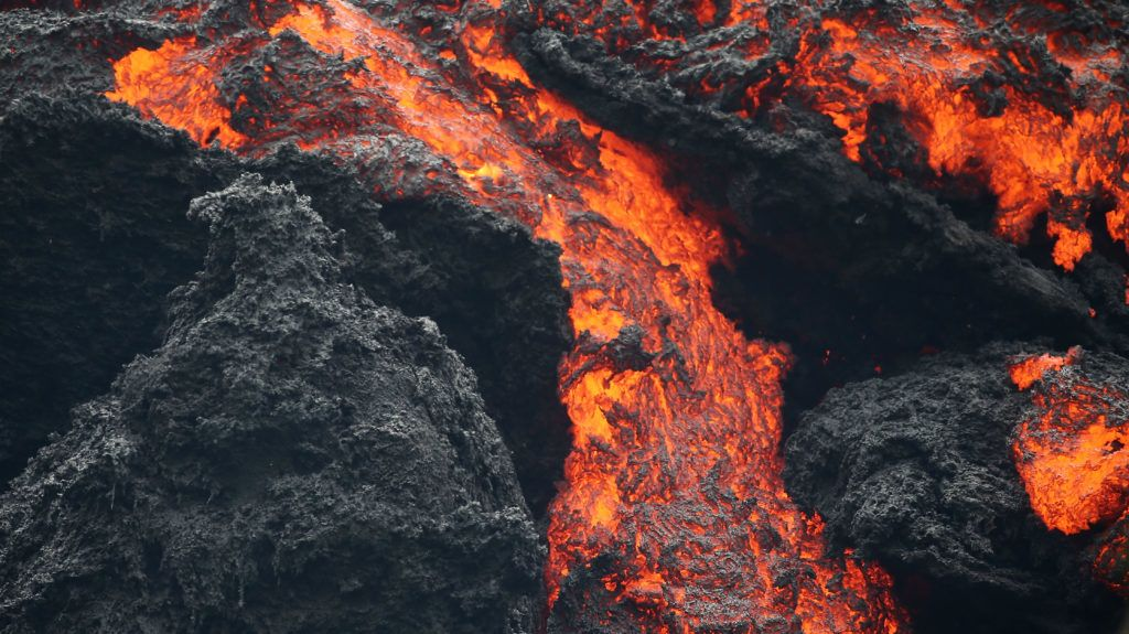PAHOA, HI - MAY 12: Lava flows at a lava fissure in the aftermath of eruptions from the Kilauea volcano on Hawaii's Big Island, on May 12, 2018 in Pahoa, Hawaii. The U.S. Geological Survey said a recent lowering of the lava lake at the volcano's Halemaumau crater Òhas raised the potential for explosive eruptionsÓ at the volcano. Authorities have confirmed the fissure is the 16th to open.   Mario Tama/Getty Images/AFP