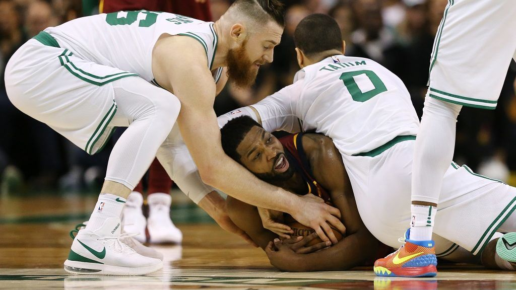BOSTON, MA - MAY 13: Tristan Thompson #13 of the Cleveland Cavaliers is defended by Aron Baynes #46 and Jayson Tatum #0 of the Boston Celtics during the second quarter in Game One of the Eastern Conference Finals of the 2018 NBA Playoffs at TD Garden on May 13, 2018 in Boston, Massachusetts.   Maddie Meyer/Getty Images/AFP