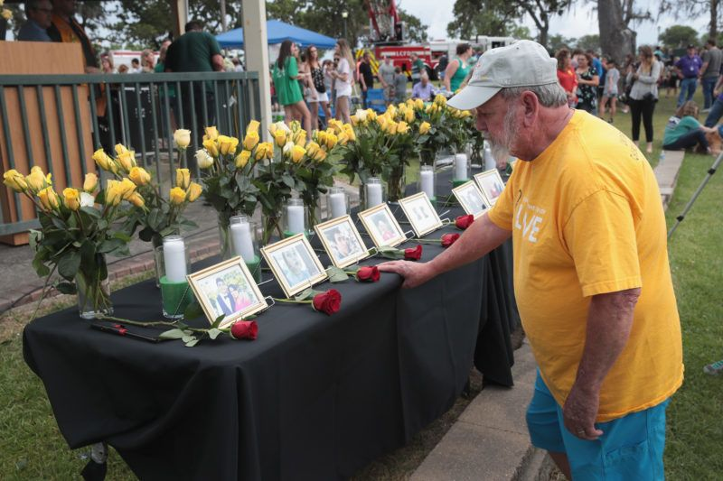 LEAGUE CITY , TX - MAY 20: Pictures of victims of the Santa Fe High School shooting are displayed during a prayer vigil at Walter Hall Park on May 20, 2018 in League City, Texas. Last Friday, 17-year-old student Dimitrios Pagourtzis entered the school with a shotgun and a pistol and opened fire, killing 10 people.   Scott Olson/Getty Images/AFP