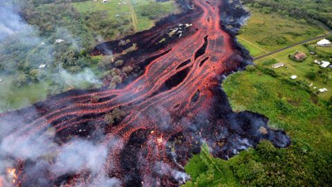 """HAWAII, USA - MAY 22: (----EDITORIAL USE ONLY – MANDATORY CREDIT - """"USGS / HANDOUT"""" - NO MARKETING NO ADVERTISING CAMPAIGNS - DISTRIBUTED AS A SERVICE TO CLIENTS----) Ash plume rises from forest following a massive volcano eruption on Kilauea volcano in Hawaii, United States on May 22, 2018. Lava is spewing more than 60 metres into the air and spread around 36,000 square metres. USGS / Handout / Anadolu Agency"""