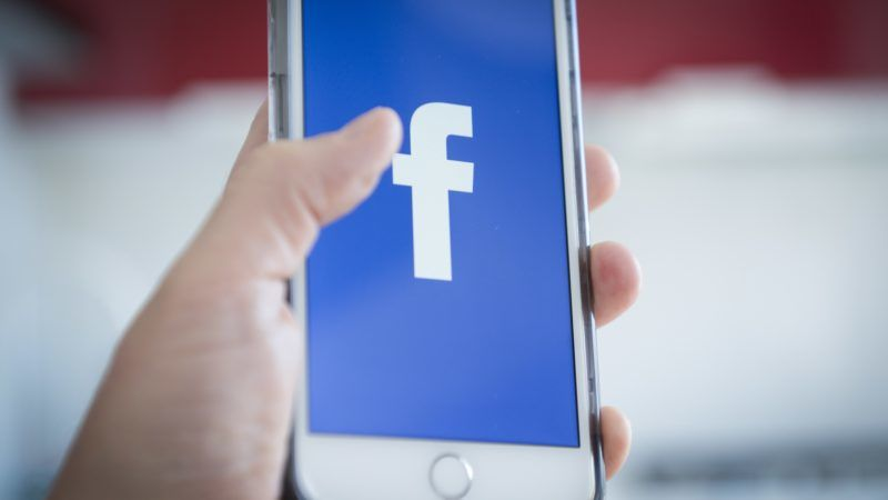 The Facebook logo is seen on a mobile device in this photo illustration on May 7, 2018. (Photo by Jaap Arriens/NurPhoto)