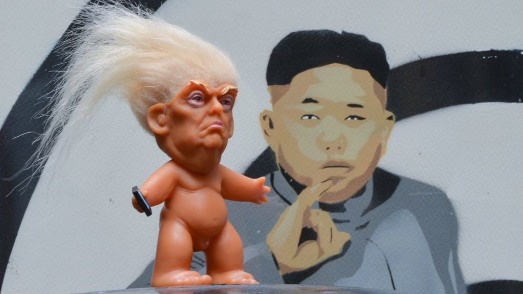 A vinyl doll which features President Donald Trump, made by a former sculptor for Disney, Chuck Williams, placed near a satiric painting of supreme leader of North Korea, Kim Jong-un, painted by Irish artist Solus. Donald Trump Troll dolls can be seen and bought at Balla Ban Art Gallery in Dublin city center. On Wednesday, 24 October 2017, in Dublin, Ireland. (Photo by Artur Widak/NurPhoto)
