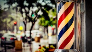Rain collecting on a barber shop pole in southern California.