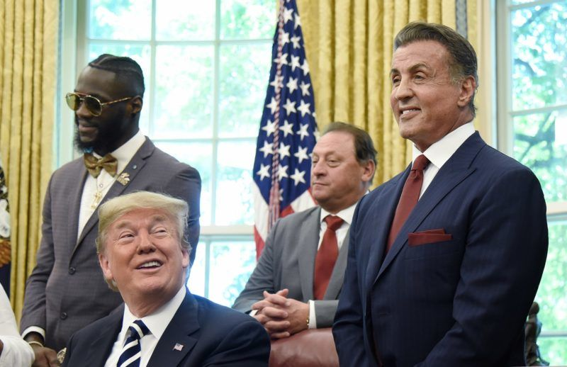 U.S. President Donald Trump speaks after signing an executive order granting a posthumouspardon for Jack Johnson, the first black heavyweight boxing champion, as actor Sylvester Stallone, left, attends in the Oval Office of the White House in Washington, D.C., U.S., on Thursday, May 24, 2018. Johnson was convicted of racially tinged federal morals charges more than a century ago. Photographer: Olivier Douliery/Pool via Bloomberg