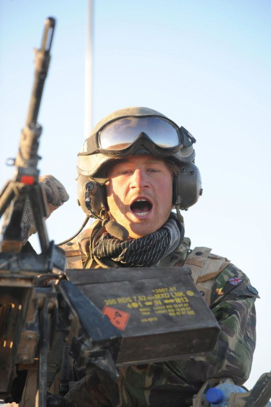 (NO PUBLICATION IN UK MEDIA FOR 28 DAYS) Prince Harry speaks on the radio from the turret of his Spartan armoured vehicle in the desert on February 20, 2008 in Helmand Province, Afghanistan. (Photo by Anwar Hussein Collection/ROTA/WireImage)