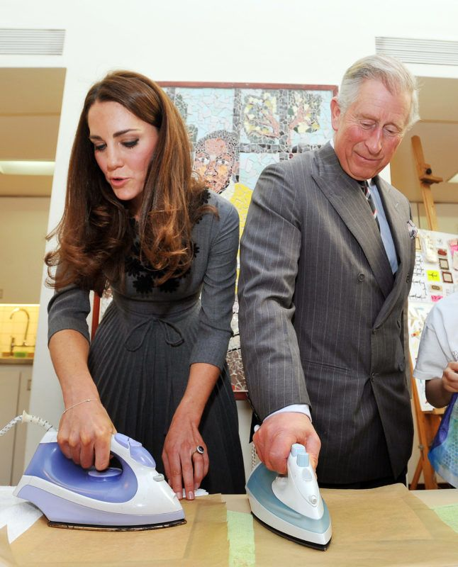 LONDON, UNITED KINGDOM - MARCH 15:  Catherine, Duchess of Cambridge and Prince Charles, Prince of Wales iron artwork onto silk during a visit to the Dulwich Picture Gallery on March 15, 2012 in London, England. The Duchess of Cambridge joined her parents-in-law Prince Charles, Prince of Wales and Camilla, Duchess of Cornwall on a royal visit to the gallery to celebrate their shared love of the arts and see work done by the Prince's Foundation for Children and the Arts. (Photo by Rota/Anwar Hussein Collection/Getty Images)