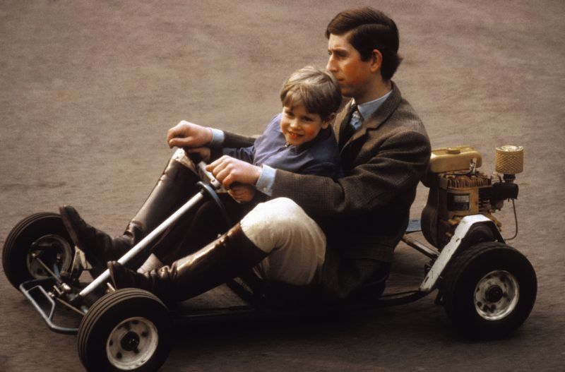 WINDSOR, UK - MAY 1969:  Prince Charles and his youngest brother Prince Edward go for a spin in their go-kart on the grounds of Windsor Castle in May 1969 near Windsor, Berkshire, England.  (Photo by Anwar Hussein Collection/Getty Images)