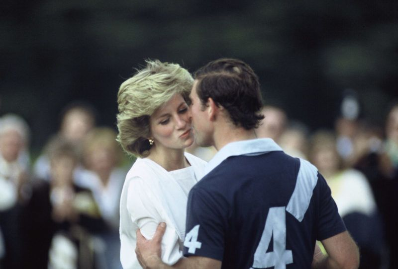 CIRENCESTER - JUNE 30:  Prince Charles, Prince of Wales and Princess Diana, Princess of Wales kiss as they attend a polo match at Cirencester Park on June 30, 1985 in Cirencester, England. (Photo by Anwar Hussein/Getty Images)