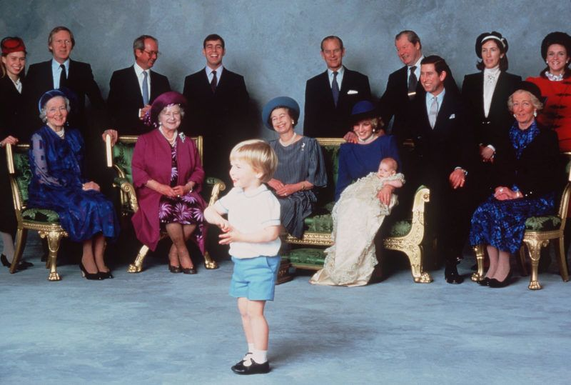 WINDSOR - DECEMBER 21:   Surrounded by Royal relatives and godparents who are amused at the antics of young Prince William, Prince Harry is christened at Windsor Castle on December 21, 1984 in Windsor, England . (Photo by Anwar Hussein/Getty Images)