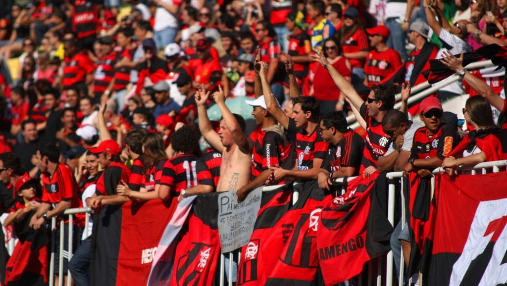 CHAPECO, BRAZIL - AUGUST 3: Flamengo fans cheer for their team during the match between Chapecoense and Flamengo for the Brazilian Series A 2014 at Arena Conda on August 3, 2014 in Chapeco, Brazil. (Photo by Alan Pedro/Getty Images)