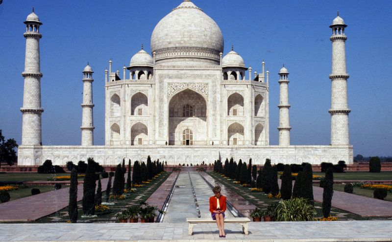 AGRA, INDIA - FEBRUARY 11:   Diana, Princess of Wales poses alone at the Taj Mahal during her visit in India on February 11, 1992. 12 years earlier her husband, the Prince of Wales, posed in the same spot.  (Photo by Anwar Hussein/Getty Images)