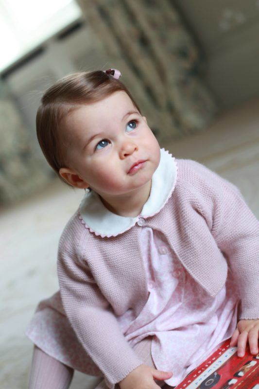 ANMER HALL, ENGLAND - APRIL 2016:  In this undated handout photo provided by HRH The Duke and Duchess of Cambridge released on May 1, 2016, Princess Charlotte of Cambridge looks up as her mother Catherine, Duchess of Cambridge takes her photo ahead of her first birthday on May 2, 2016 at Anmer Hall on April 2016 in Norfolk, England. The young Princess will celebrate her first birthday on May 2. (Photo by HRH The Duchess of Cambridge via Getty mages) EDITORIAL USE ONLY. NO COMMERCIAL USE (including any use in merchandising, advertising or any other non-editorial use including, for example, calendars, books and supplements). This photograph is provided to you strictly on condition that you will make no charge for the supply, release or publication of it and that these conditions and restrictions will apply (and that you will pass these on) to any organisation to whom you supply it. All other requests for use should be directed to the Press Office at Kensington Palace in writing.