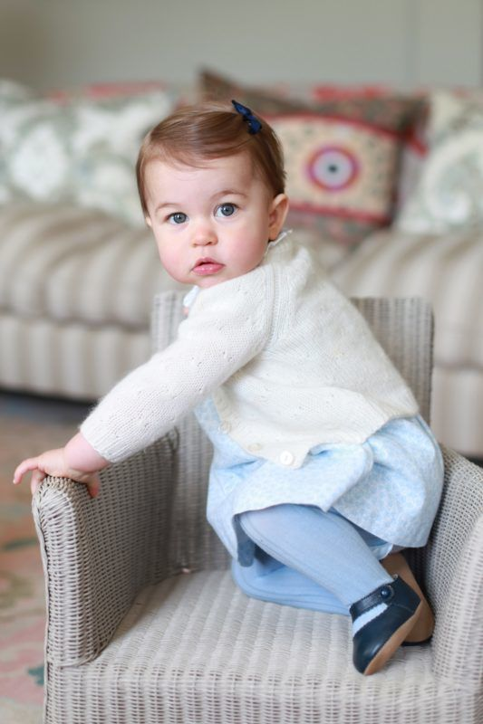 ANMER HALL, ENGLAND - APRIL 2016:  In this undated handout photo provided by HRH The Duke and Duchess of Cambridge released on May 1, 2016, Princess Charlotte of Cambridge looks up on a chair as her mother Catherine, Duchess of Cambridge takes her photo ahead of her first birthday on May 2, 2016 at Anmer Hall on April 2016 in Norfolk, England. The young Princess will celebrate her first birthday on May 2. (Photo by HRH The Duchess of Cambridge via Getty mages) EDITORIAL USE ONLY. NO COMMERCIAL USE (including any use in merchandising, advertising or any other non-editorial use including, for example, calendars, books and supplements). This photograph is provided to you strictly on condition that you will make no charge for the supply, release or publication of it and that these conditions and restrictions will apply (and that you will pass these on) to any organisation to whom you supply it. All other requests for use should be directed to the Press Office at Kensington Palace in writing.