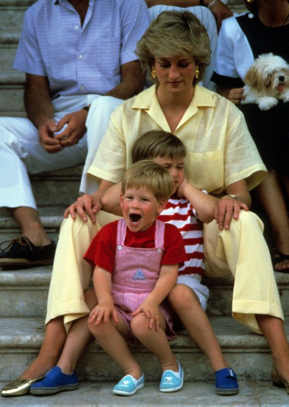 MAJORCA-AUGUST 10: (FILE PHOTO) Princess Diana, Princess of Wales with Prince William and Prince Harry on holiday in Majorca, Spain on August 10, 1987. Also present were the Spanish Royal Family and the Prince of Wales.  (Photo by Anwar Hussein/Getty Images)