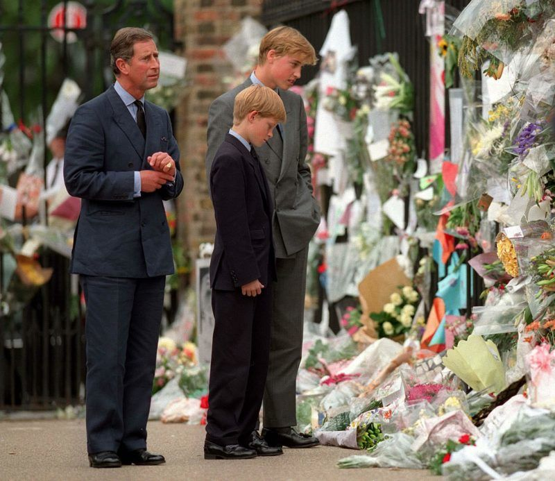 LONDON - SEPTEMBER 5: (FILE PHOTO) The Prince of Wales, Prince William and Prince Harry look at floral tributes to Diana, Princess of Wales outside Kensington Palace  on September 5, 1997 in London, England.  (Photo by Anwar Hussein/Getty Images)